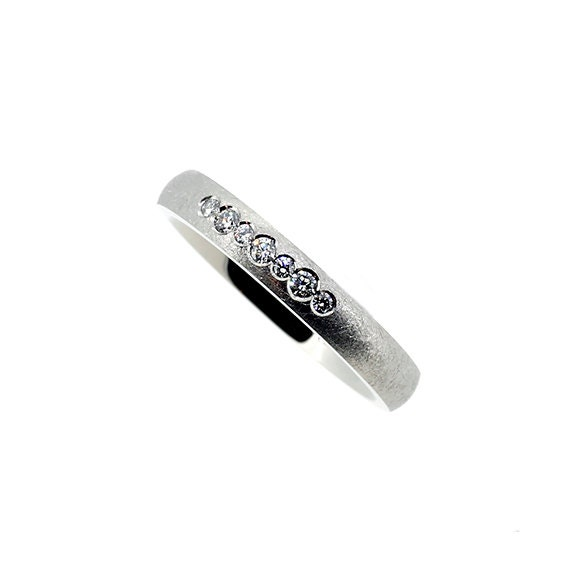 scratched white gold wedding band with diamonds modern