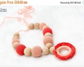 SALE 25% off Teething necklace with wooden ring pendant in pastel peach and coral. Nursing/breasfeeding mom accessory
