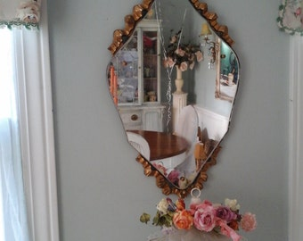 Vintage mirror with bow