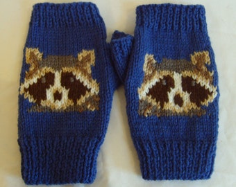 Racoon Intarsia Fingerless Mitts on an mid-blue background