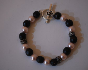 Bracelet with Pink Pearls and Black Wooden Beads with Flower Silver Spacers and Silver Toggle