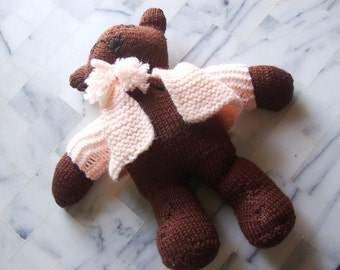 Adorable handknit brown bear.