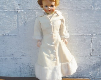 2 1/2 foot tall vintage open closing eyes blinking  doll  short hair beige dress and coar