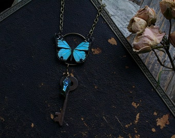Antique blue butterfly with 1800s Victorian cast iron skeleton key, wire wrapped blue titanium crystal quartz necklace