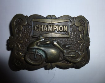 Brass Belt Buckle - 1978 - Champion Spark Plug Company -  Motorcycle Racer -