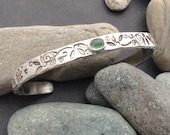 Sterling silver cuff bracelet, slim thick solid sterling with green tourmaline gemstone, abstract leaf and vine designs