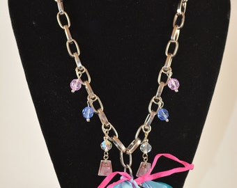 Metal and charm Pendant-Style Necklace with Ribbon Accent