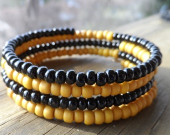 4 Strand Memory Wire Bracelet in Black and Gold Glass Beads