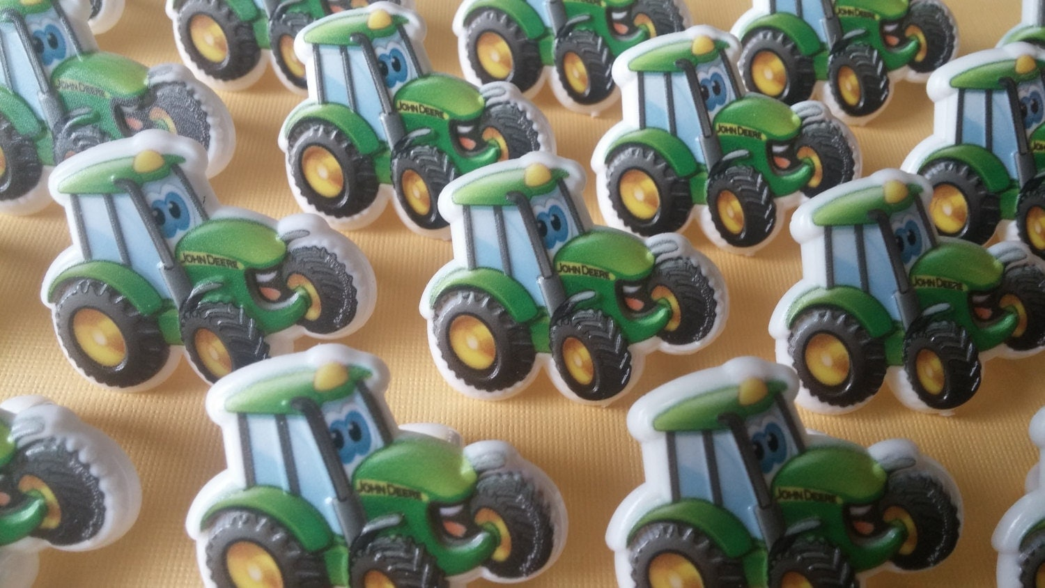 It is a picture of Intrepid John Deere Cupcake Toppers