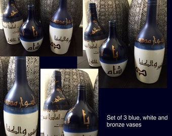Three white and blue vase. With arabic calligraphy desigb applied with special material.