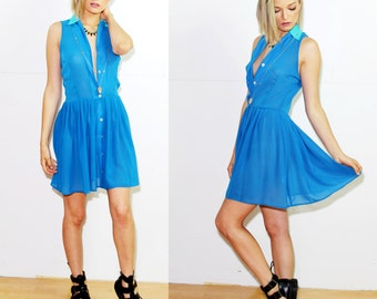 "Voyage Clothing ""burano"" sleeveless button down dress in bright blue"