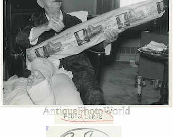 Louis Lurie w cigar and giant french loaf bread photo