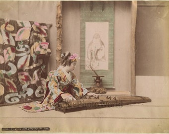 Japan beautiful woman geisha playing koto antique tinted music albumen photo
