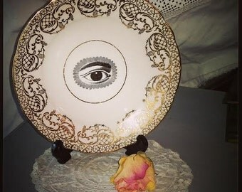 Vintage plate with eye design steampunk