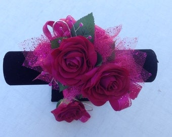Corsage designed in hot pink real touch roses