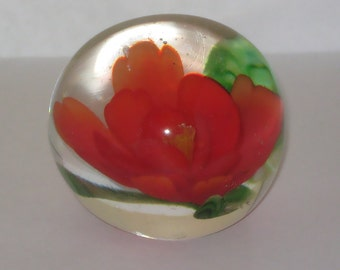 Glass Clear with a Red Flower and Green Leaves Paperweight Round