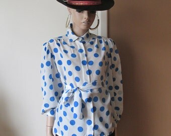 Vintage silk polka-dot blouse.Ties with a sash.Made in France.