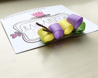 Catepillar ribbon sculpture bow