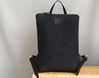 Black waterproof waxed canvas backpack
