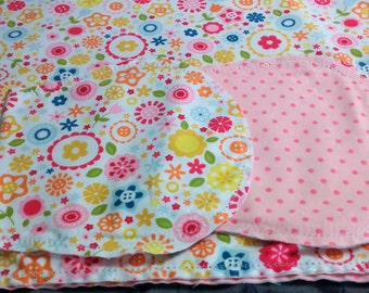 Multi Colored Flowers with Pink Poke Dot Backing Hemstitched Baby Blanket and Burps ready for you to crochet by Lindas Hemstitching