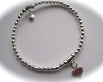 Mother Sterling Silver puffed heart and stamped heart stretch bead Bracelet