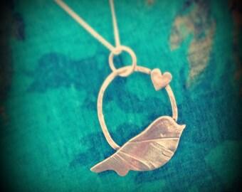 Bird and heart pendant