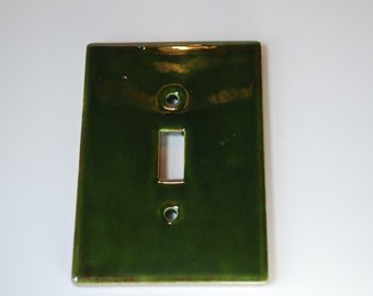 Green and marbled brown glaze  ceramic single switch plate.