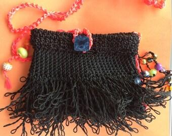 Black and neon pink crochet cross body bag