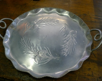 Forged aluminum round tray with pine cones