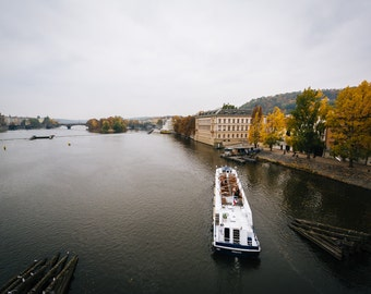 Boat in the Vltava, on a cloudy autumn day, in Prague, Czech Republic - Photography Fine Art Print or Wrapped Canvas