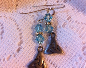 Light aqua and sterling silver pierced earrings with Trinity knot charms.