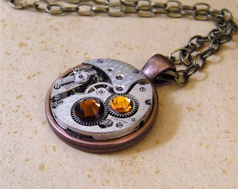 Steampunk Necklace / Pendant - Featuring a Vintage Watch Movement & Swarovski Crystals. Jamlincrow