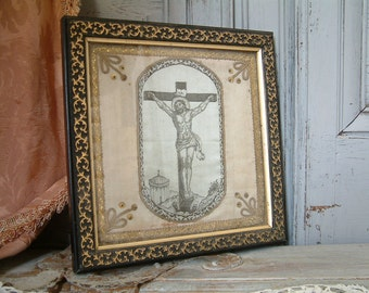 Antique french silk crucifix in ebonized and gilded wood frame. Devotional silk Christ in frame. Ex-voto art. Christian devotional art