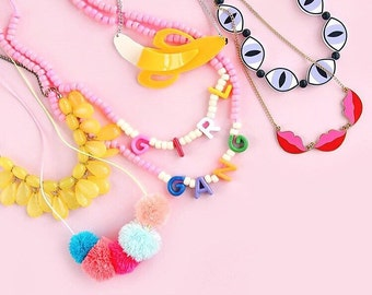 Pom pom necklace on neon ombre cord