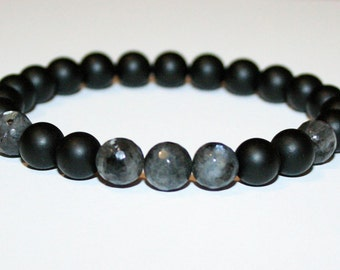 Black onyxs mooth and faceted Larvikite stretch bracelet.