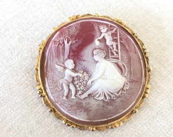 Cameo mother and children brooch