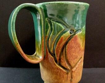 Ceramic coffee mug-Tea mug-green ceramic mug - coffee cup: wheel thrown with dolphin and marlin motifs in low relief.