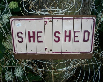 She Shed sign recycled license plate