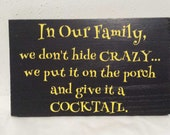 In our family we don't hide the crazy...we put it on the porch and give it a cocktail, Hide the crazy, Don't hide the crazy, Family sign