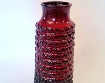 Splendid red glazed ceramic made vase, and made in west Germany.