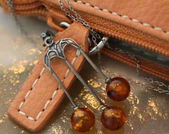 Lovely antique amber and sterling silver trident necklace