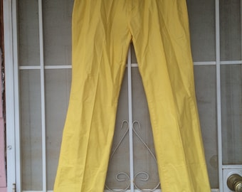 Late 1970s yellow highwaisted bootcut pants with embroidered parrot embellishment size 27