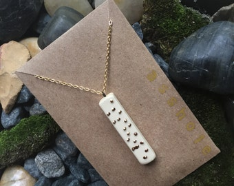 """Braille necklace in """"as#hole"""""""