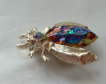 Vintage rhinestone and carnival glass bug brooch