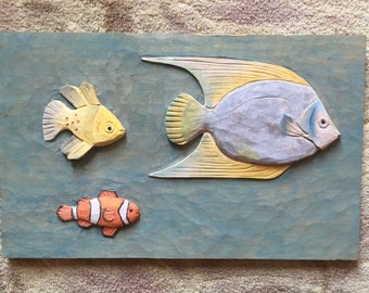 Relief carving of 3 fish