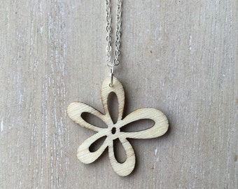 Short silver necklace with laser cut wooden flower charm