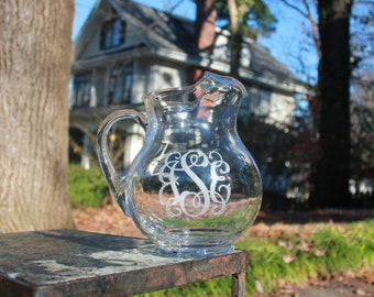 Engraved glass pitcher