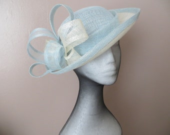 Handmade blue and cream sinamay hat.