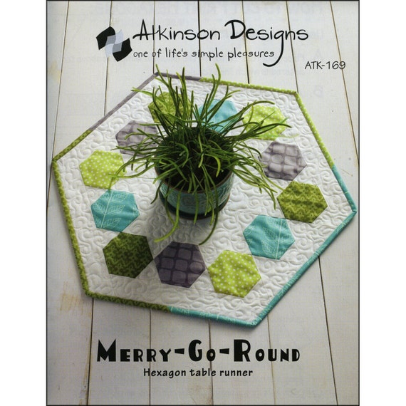 pattern merry go round table runner by atkinson designs. Black Bedroom Furniture Sets. Home Design Ideas