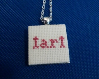 Tart cross stitch necklace in silver pendant
